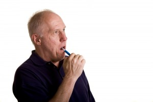 Older Man Brushing Teeth